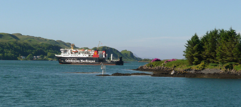 An unusual view of a CalMac vessel at anchor - taken from Waverley, departing for Tobermory. The rhododrendrons were in full bloom in great abundance around Oban - and some on Kerrera