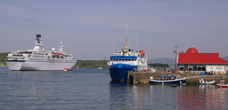 Two liners at Oban  Astor at anchor and Quest alongside North Pier
