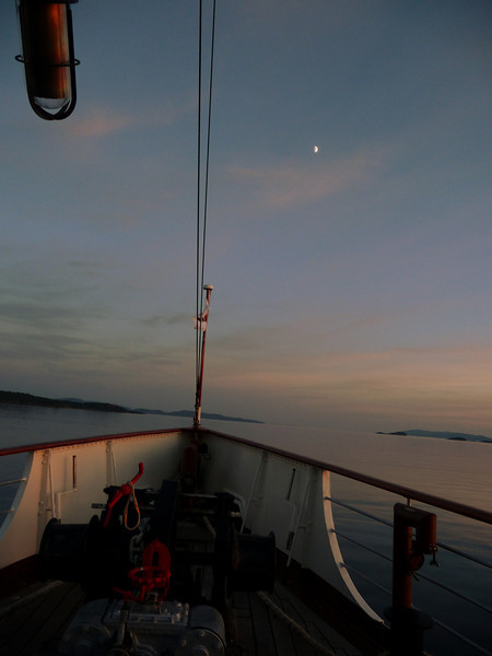 View ahead - approaching Kerrera with the moon on the starboard bow.