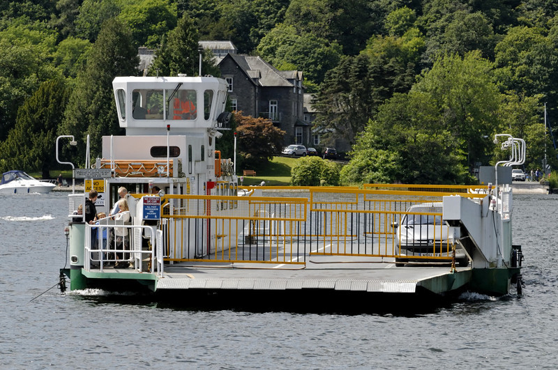 Mallard, approaching Ferry Nab, Lake Windermere, Sat 23 July 2011.  The Windermere ferry was built in 1990, is owned by Cumbria County Council and is operated by Amey Infrastructure Services.  It links Ferry Nab, on the eastern side of the lake, with Far Sawrey, a distance of just over one quarter of a mile.  The route forms part of the B5285 road.  The ferry is guided by blue nylon cables, as seen at left.