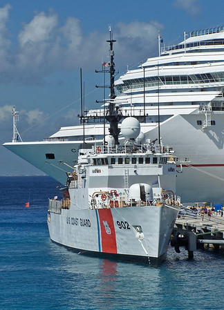 The 270 ft USCG Cutter Tampa is dwarfed by a cruise ship in Cozumel, Mexico. 2008
