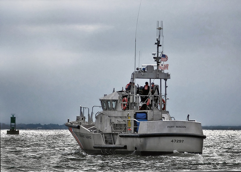 A 47 ft Coast Guard boat leaves Station Fort Macon, NC for a patrol under threatening skies. 2008