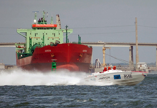 Race boat safely crossing the bow of the Sulpher tanker Aurora. Morehead City, NC. 2008