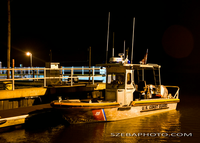 A US Coast Guard 24 foot craft under evening lights -2014
