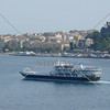 Tour boat cruising at the port in Corfu, Greece.