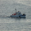 Pilot boat cruising off the coast of Alaska.