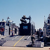 Date: unknown - Location: Okaloosa County, FL<br /> Class:  Landing Craft Air Cushion (LCAC)<br /> Hull Number:  66<br /> Misc:  The object on the LCAC is an attempt to build a removable system to provide mobile close in fire support during beach landings. It consists of standard shipping containers with a MAU12 bomb rack and a GPU-5 (30mm) gun. On top of that was the scene image section of a AGM54 Maverick. Reportedly the system on a standard LCAC was referred to as a Gun Platform Air Cushion (GPAC).