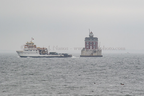 The ferry Race Point heads outbound past New London Harbor