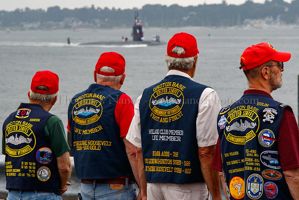 A group of Submarine Veterans watch the USS Springfield approach