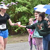 GREG SUKIENNIK - MANCHESTER JOURNAL<br /> Elizabeth Sykes, right, hands a sports drink to a runner during the Shires of Vermont Marathon on May 20, 2018. The water station was staffed by children from the Girls on the Run program in Wells.