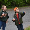 GREG SUKIENNIK - MANCHESTER JOURNAL<br /> Elizabeth Sykes, left, and Talen Chalmers, both of Wells, take in the sights at a water station during the Shires of Vermont Marathon on May 20 ,2018.