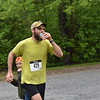 GREG SUKIENNIK - MANCHESTER JOURNAL<br /> A runner takes a drink provided by children from the Girls on the Run program in Wells during the Shires of Vermont Marathon in Manchester on May 20, 2018.
