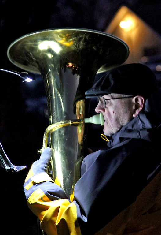 . Playing holiday music on the tuba is John Breyer of Littleton and a member of the Nashoba Valley Concert Band, at the Shirley Tree Lighting. Nashoba Valley Voice Photo/David H. Brow