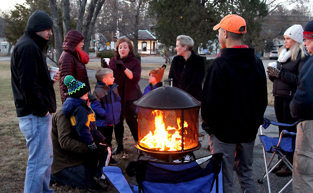 ". Keeping warm and drinking hot coco around an open fire as locals await ""Santa\"" for the Shirley tree lighting at Whiteley Park. Nashoba Valley Voice Photo/David H. Brow"