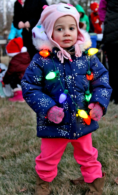 . All decked out as a little Christmas Tree is Stella Michaud, 3, of Shirley, as she waits for the start of the Shirley Tree Lighting. Nashoba Valley Voice Photo/David H. Brow
