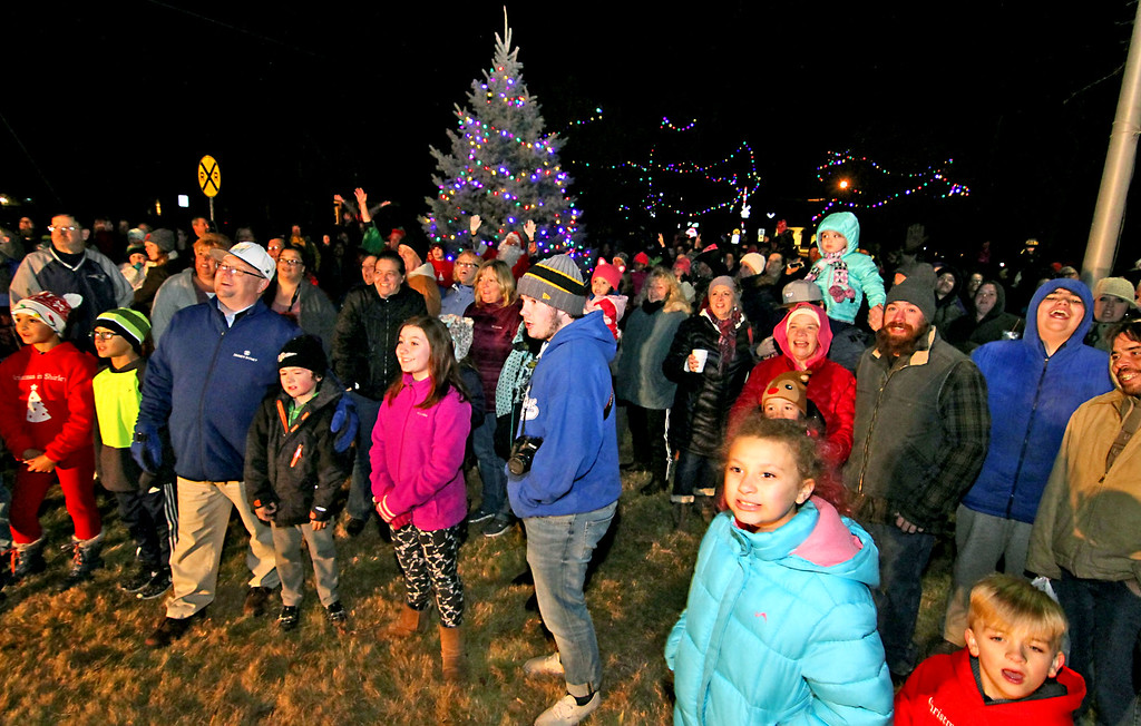 . Crowds reacts as the holiday lights go on at Shirley Tree Lighting ceremony at Whiteley Park. Nashoba Valley Voice Photo/David H. Brow