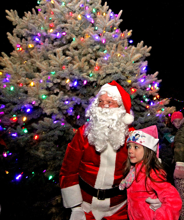 . Veronica Egan, 5, is happy to have her photo taken with Santa by her mom, Melanie Egan of Shirley, at the Shirley Tree Lighting ceremony. Nashoba Valley Voice Photo/David H. Brow
