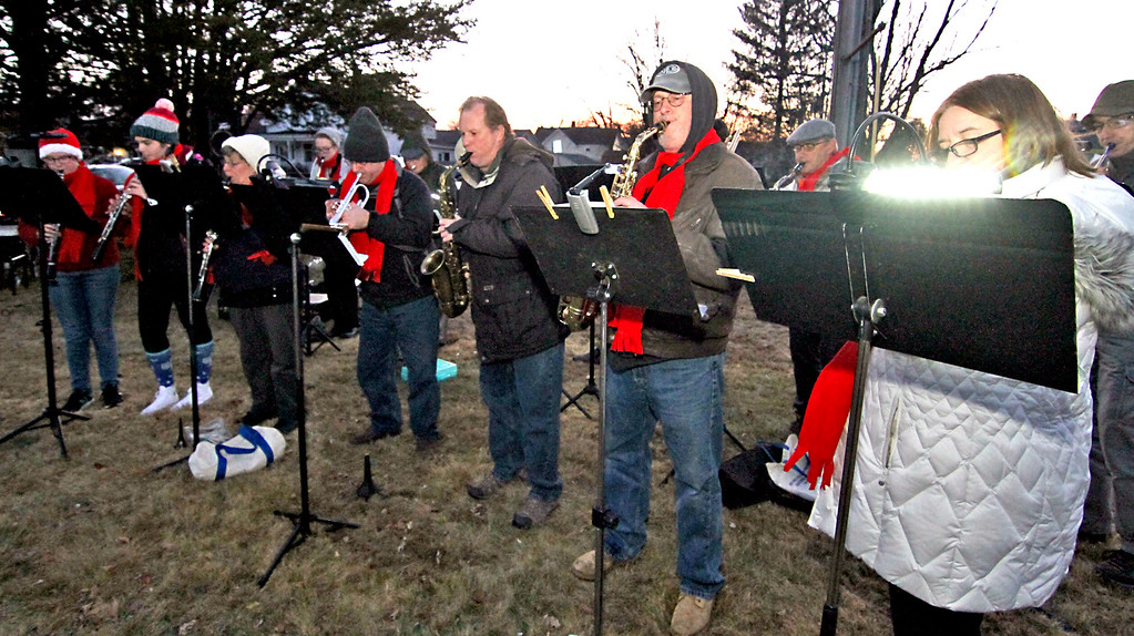 . Members of the Nashoba Valley Concert Band, kick-off the Shirley Tree Lighting ceremony  with holiday music on Whiteley Park. Nashoba Valley Voice Photo/David H. Brow
