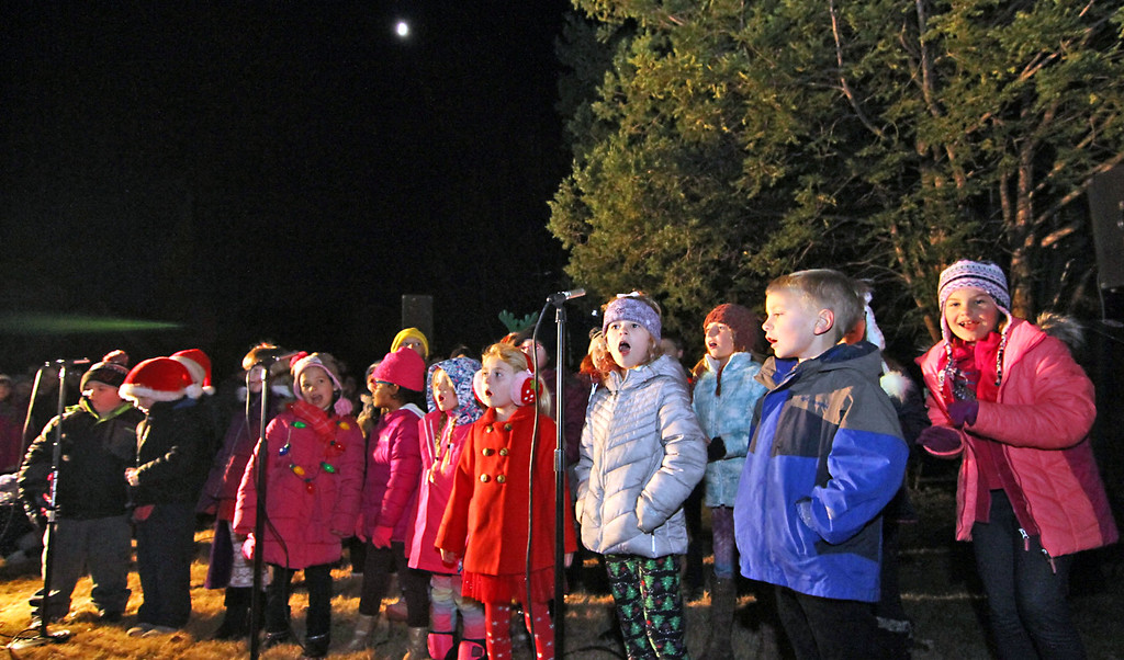 . Singing holiday songs as they await the arrival of Santa are members of the Shirley Children\'s Touring Christmas Choir. Nashoba Valley Voice Photo/David H. Brow