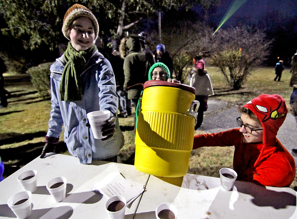 . Members of Venture Crew #34(co-ed scouting troop), hands out hot coco at the Shirley Tree Lightging, L-R, Brianna Schmoyer,15, of Harvard, Erica Bowe, 19, of Bolton and Dylan Bourassa,16, of Shirley. Nashoba Valley Voice Photo/David H. Brow