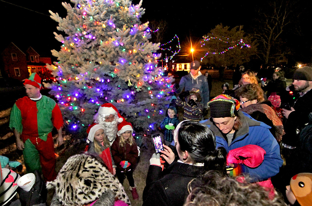 . Locals having their photos taken with Santa at the Shirley Tree Lighting ceremony. Nashoba Valley Voice Photo/David H. Brow