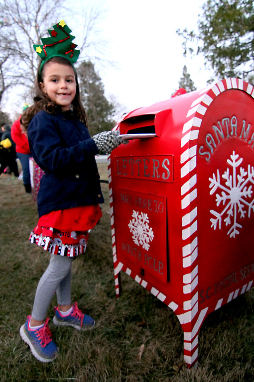. Sending off a letter to Santa is Adia Brown,6, of Shirley, as she waits for the Shirley Tree Lighting on Whiteley Park. Nashoba Valley Voice Photo/David H. Brow