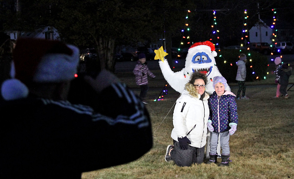 . Local photographer Todd Maki, takes Photo-Opp pictures for people before the Shirley Tree Lighting, having photos done is Nicole Warren with her daughter Rylee Warren, 5 from Shirley. Nashoba Valley Voice Photo/David H. Brow