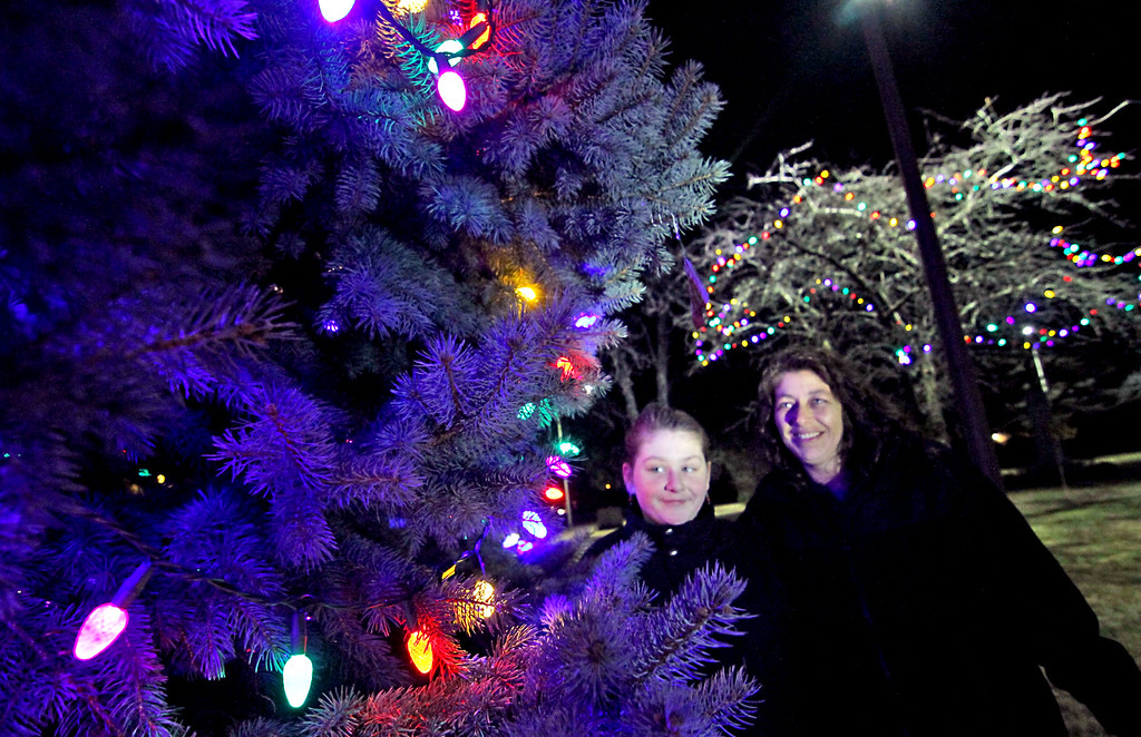 . Jenna Despres, 11, and her mom, Elaine Johnson both of Shirley, take in all the colors at the Shirley Tree Lighting ceremony on Whiteley Park. Nashoba Valley Voice Photo/David H. Brow