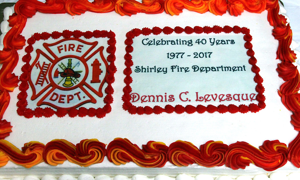 . Here is the 40th Anniversary party cake that greeted Shirley Fire Chief Dennis Levesque. Nashoba Valley Voice Photo by David H./ Brow.