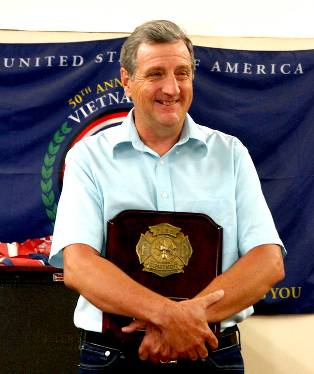 . Shirley Fire Chief Dennis Levesque is all smiles after receiving a plaque from his dept., for 40 years of service. Nashoba Valley Voice Photo by David H. Brow.