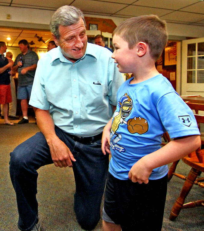 . Shirley Fire Chief Dennis Levesque has a chat with his great grand nephew, Jett Hemenway 4 years old. Nashoba Valley Voice Photo by David H. Brow.