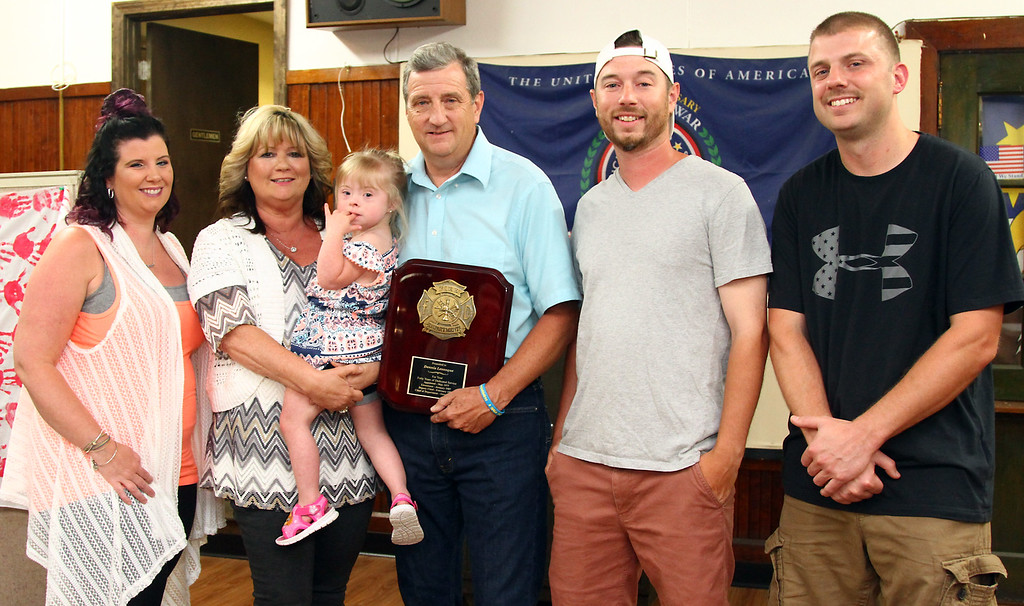 . Chief Levesque with family members L-R, Kristy Levesque(daughter), Colleen Levesque, wife, holding grandaughter Karlee O\'Connor, Matt Levesque (son) and Brandon O\'Connor (son-in-law). Nashoba Valley Voice Photo by David H. Brow.