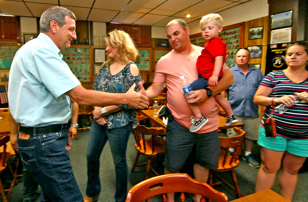 . Shirley Fire Chief Dennis Levesque, on left, is greeted by Adam Ouelette holding his son, Caden Ouelette, 2. Nashoba Valley Voice Photo by David H. Brow.