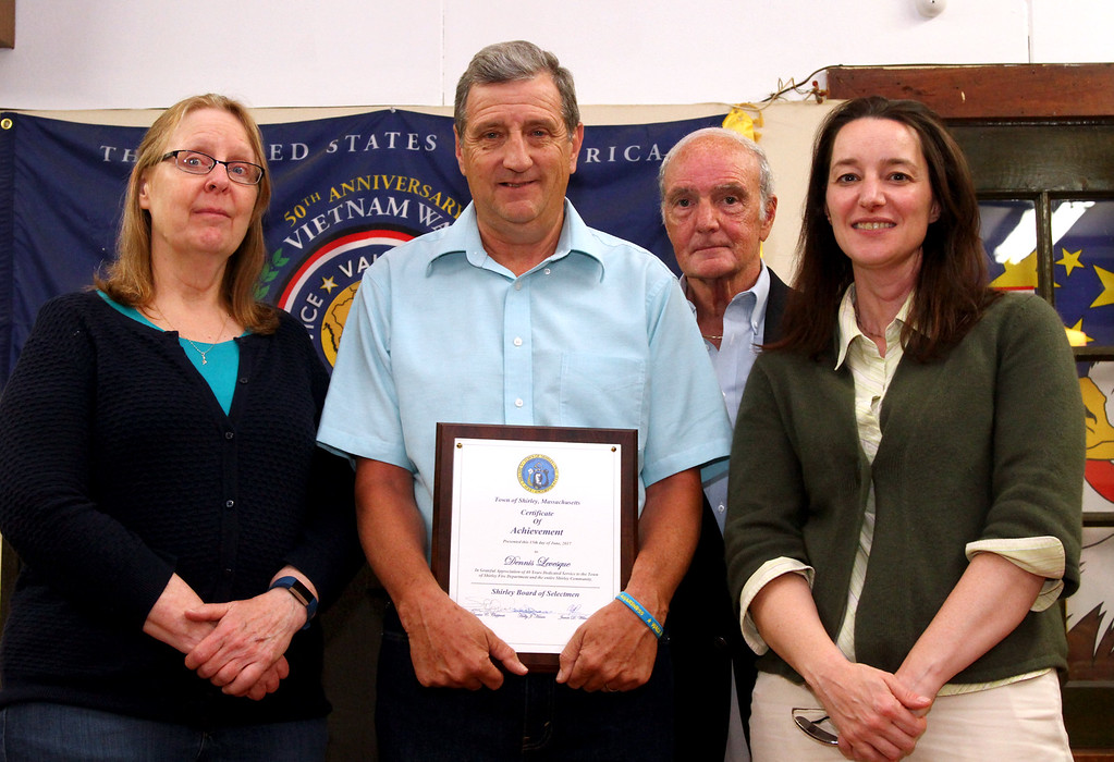 . Shirley Fire Chief with town officals, L-R,Selectwoman Holly Haase, Chief Levesque, Chairman of the Bd of Selectmen Rico Cappucci, and town admin., Patrice Garvin. Nashoba Valley Voice Photo by David H. Brow.