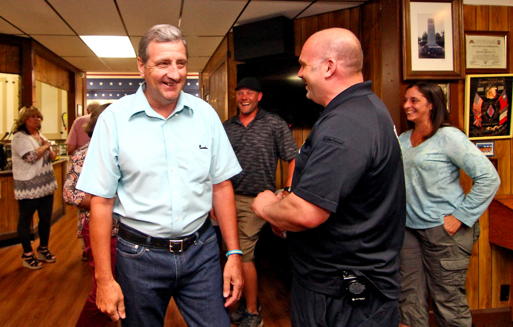 . Shirley Fire Chief Dennis Levesque, on left, is greeted by Lt. Al Deshler with the Shirley Fire Dept., Dennis is being honored for 40 years of service to the dept. Nashoba Valley Voice Photo by David H. Brow.