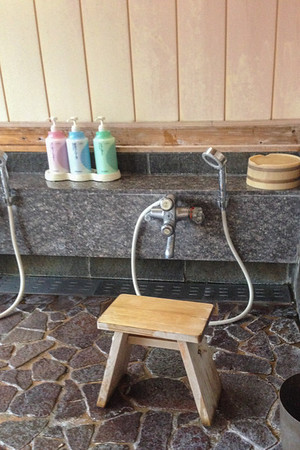 """The shower area in an """"onsen""""  Tips for Staying in a Ryokan and Onsen hot spring spa"""