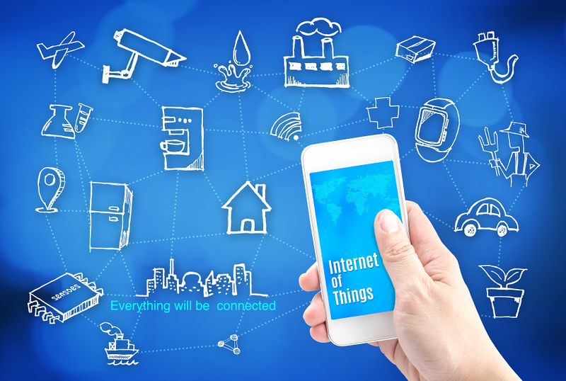 Hand holding smart phone with Internet of things (IoT) word and object icon and blur background, Network Technology concept.