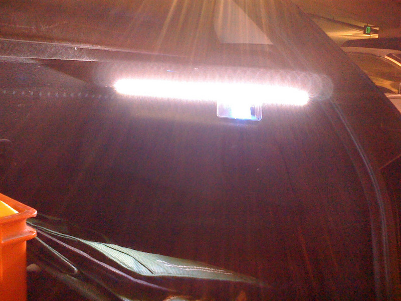 """Right side of the trunk. 20"""" strip attached under the plastic flange with side-mounted LED's facing into the trunk space."""
