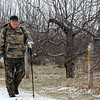 The ground was covered with a little snow at Sholan Farms and the air was filled with fog making it a dreary day on Wednesday, Jaunary 8,2019 in Leominster. That did not stop Tom Flaherty of Clinton from going out for a hike through the apple trees at the farm. SENTINEL & ENTERPRISE/JOHN LOVE