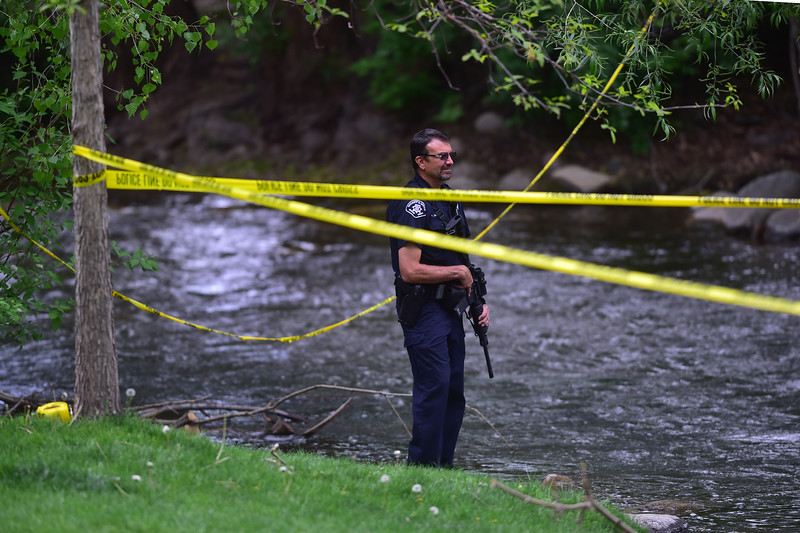 "An officer patrols an area alongside Boulder Creek in downtown after a shooting in Central Park. A man reportedly fired shots then pointed his weapon at Boulder police who shot him. <br /> More photos:  <a href=""http://www.dailycamera.com"">http://www.dailycamera.com</a><br /> Autumn Parry/Staff Photographer<br /> May 22, 2016"
