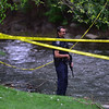 """An officer patrols an area alongside Boulder Creek in downtown after a shooting in Central Park. A man reportedly fired shots then pointed his weapon at Boulder police who shot him. <br /> More photos:  <a href=""""http://www.dailycamera.com"""">http://www.dailycamera.com</a><br /> Autumn Parry/Staff Photographer<br /> May 22, 2016"""