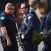 """Longmont Police officers gather after evacuating the Boulder Public Library in search for a suspect after a shooting in Central Park. A man reportedly fired shots then pointed his weapon at Boulder police who shot him. <br /> More photos:  <a href=""""http://www.dailycamera.com"""">http://www.dailycamera.com</a><br /> Autumn Parry/Staff Photographer<br /> May 22, 2016"""