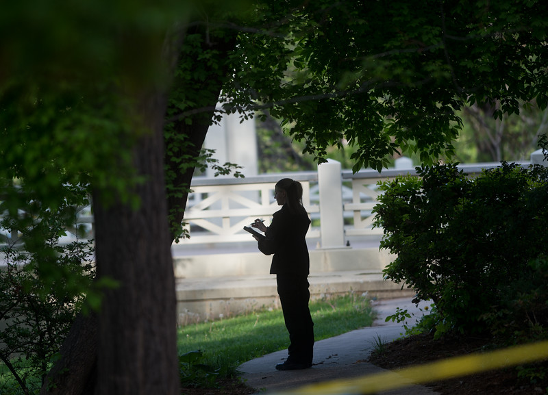 "An investigator works on scene after a shooting near Boulder Creek in Central Park on Sunday.<br /> More photos:  <a href=""http://www.dailycamera.com"">http://www.dailycamera.com</a><br /> Autumn Parry/Staff Photographer<br /> May 22, 2016"