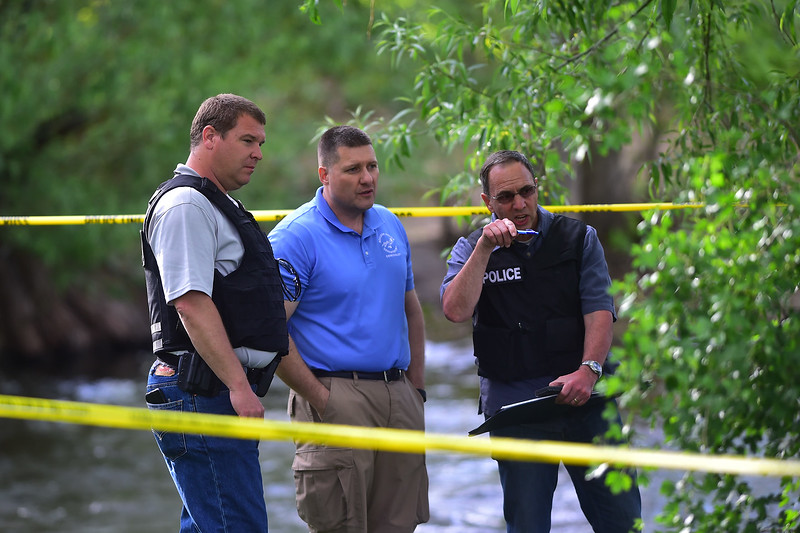 "Police investigate a shooting near Boulder Creek in Central Park. A man reportedly fired shots then pointed his weapon at Boulder police who shot him. <br /> More photos:  <a href=""http://www.dailycamera.com"">http://www.dailycamera.com</a><br /> Autumn Parry/Staff Photographer<br /> May 22, 2016"