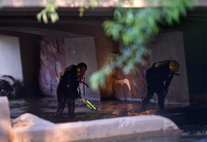 "Divers from the Boulder Fire and Rescue Dive Team search Boulder Creek under the Broadway St. bridge after a shooting in Central Park on Sunday.<br /> More photos:  <a href=""http://www.dailycamera.com"">http://www.dailycamera.com</a><br /> Autumn Parry/Staff Photographer<br /> May 22, 2016"