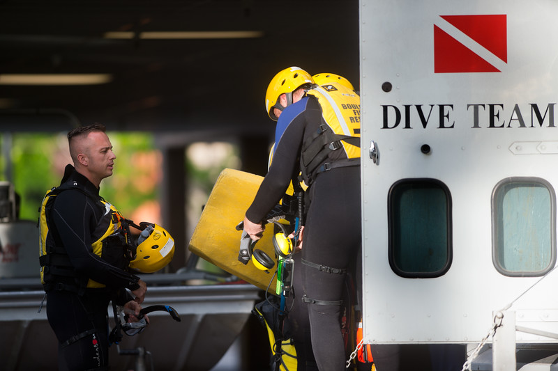 "The Boulder Fire and Rescue Dive Team prepare to go into Boulder Creek after a shooting in Central Park on Sunday afternoon.<br /> More photos:  <a href=""http://www.dailycamera.com"">http://www.dailycamera.com</a><br /> Autumn Parry/Staff Photographer<br /> May 22, 2016"