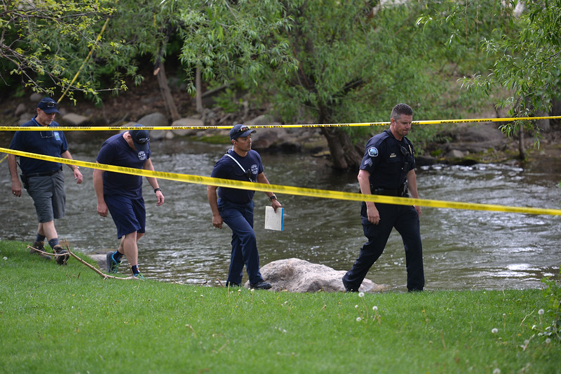 "An officer leads responders along Boulder Creek near the Broadway St. bridge after a shooting in Central Park on Sunday.<br /> More photos:  <a href=""http://www.dailycamera.com"">http://www.dailycamera.com</a><br /> Autumn Parry/Staff Photographer<br /> May 22, 2016"