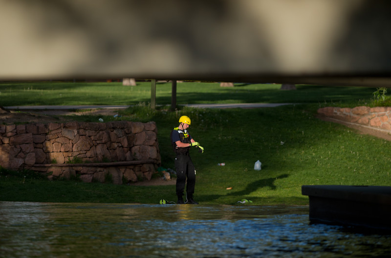 "A member of the Boulder Fire and Rescue Dive Team prepares to go into Boulder Creek after a shooting in Central Park on Sunday afternoon.<br /> More photos:  <a href=""http://www.dailycamera.com"">http://www.dailycamera.com</a><br /> Autumn Parry/Staff Photographer<br /> May 22, 2016"