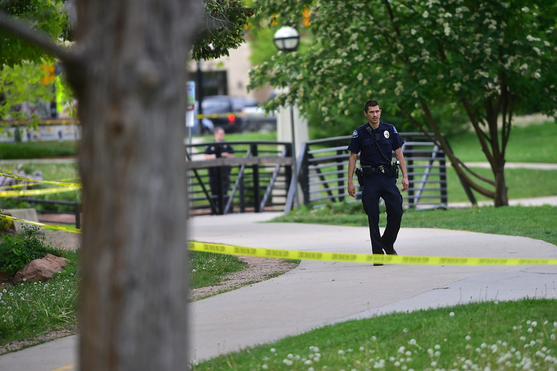 "An officer patrols the Boulder Creek area in downtown after a shooting in Central Park. A man reportedly fired shots then pointed his weapon at Boulder police who shot him. <br /> More photos:  <a href=""http://www.dailycamera.com"">http://www.dailycamera.com</a><br /> Autumn Parry/Staff Photographer<br /> May 22, 2016"