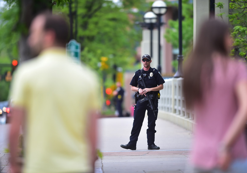 "An officer patrols the Broadway St. bridge over Boulder Creek in downtown after a shooting in Central Park. A man reportedly fired shots then pointed his weapon at Boulder police who shot him. <br /> More photos:  <a href=""http://www.dailycamera.com"">http://www.dailycamera.com</a><br /> Autumn Parry/Staff Photographer<br /> May 22, 2016"